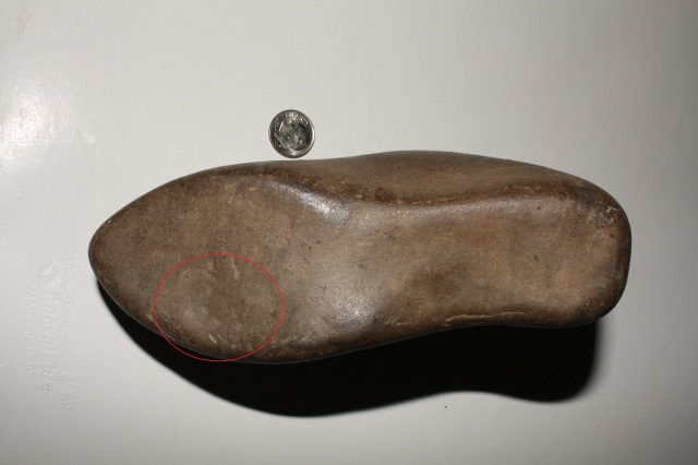 Bottom of (Clovis) shoe stone from the Susquehanna River, Millersburg, PA, showing brown (comet-spatter) nodules over (Clovis) tool marks, circled in red, where the rock has apparently been modified to appear more slipper like