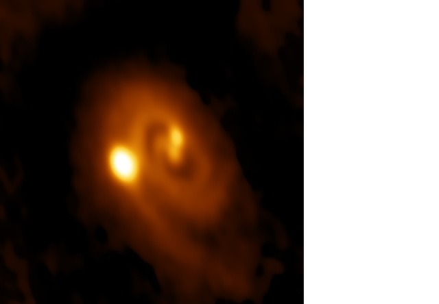 Protostar system L1448 IRS3B, showing central binary pair (IRS3B-a & IRS3B-b) orbited by a less massive but much brighter tertiary protostar (IRS3B-c) in a circumbinary orbit. Image Credit: Bill Saxton, ALMA (ESO/NAOJ/NRAO), NRAO/AUI/NSF - Publication: John Tobin (Univ. Oklahoma/Leiden) et al.