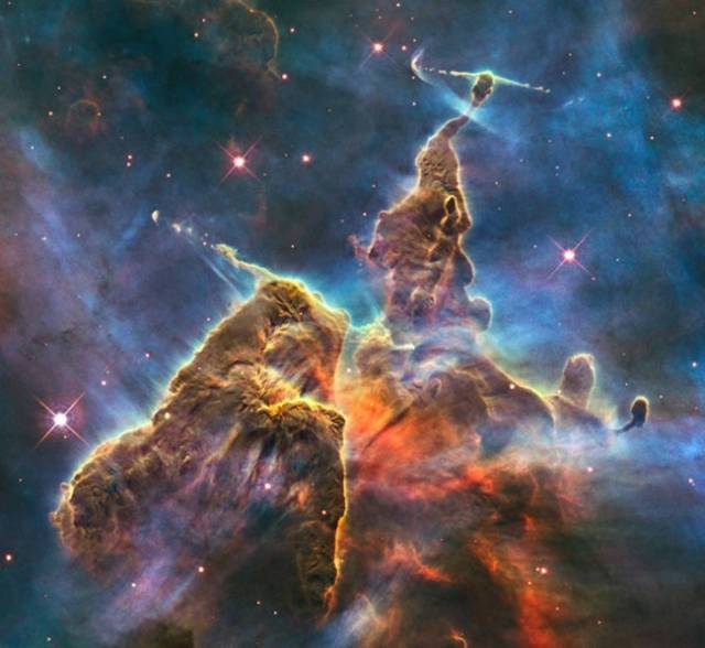 Carina Nebula  Giant molecular clouds are the suggested luminous cousins to dark 'globule clusters' composed of invisible (Bok) globules with their luminous stellar metallicity 'snowed out' into icy chondrules.  But overexposure to giant stars in the galactic plane can sublime stellar metallicity from icy chondrules, converting dark globules to their 'excited state' with stellar metallicity in gaseous phase whence then become our familiar opaque Bok globules.  And gaseous stellar metallicity promotes Jeans instability in Bok globules which may cause the entire gravitationally-bound globule to to 'go nuclear' and convert to a gravitationally-bound star cluster.