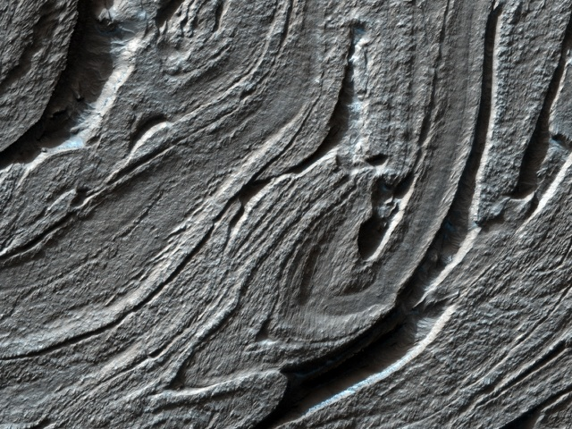 The twisted terrain exposed in Hellas basin may be multiple aqueously-differentiated, lithified, sedimentary dwarf-planet cores that merged in the Kuiper belt to form a larger dwarf planet that impacted Mars during the late heavy bombardment.
